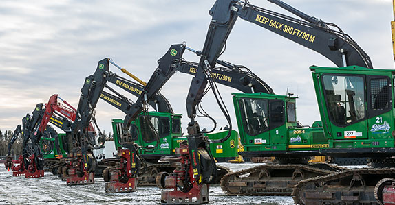 A line-up of John Deere dangle head processor's at Ritchie Bros. Prince George auction.