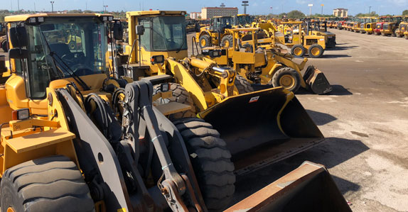 lines of wheel loaders at Ritchie Bros. auction in Orlando